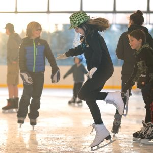 Image of children skating during a public open skating session at The Pavilion in Bend.