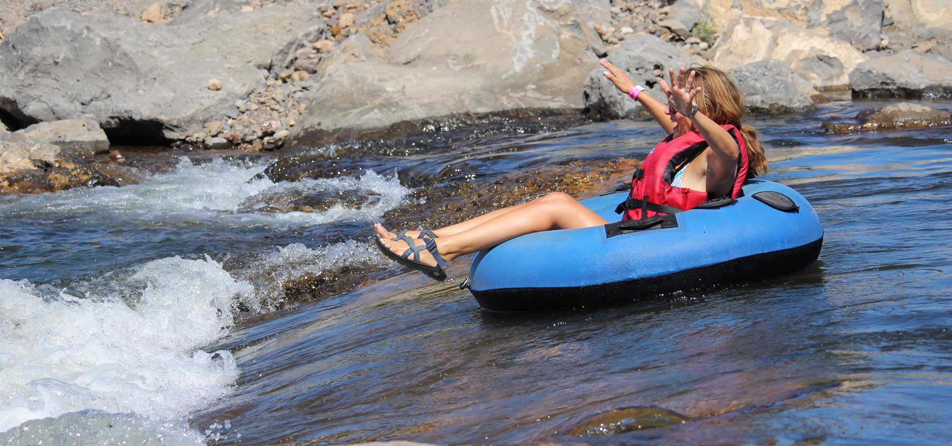 Image of a person going down the ladder, recreational floating channel of the Deschutes River through the Bend Whitewwater Park.