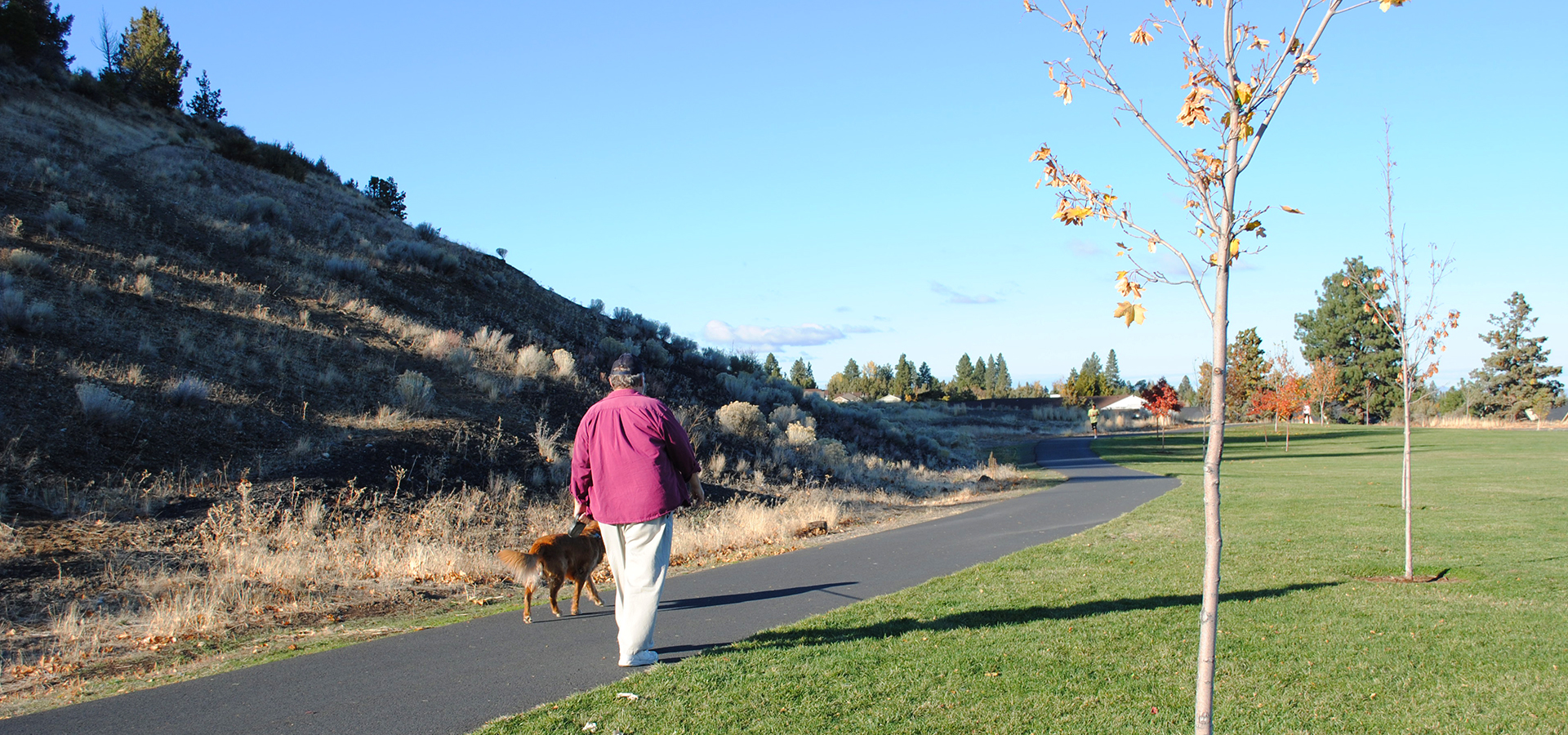 Image of a trail user walking on the Larkspur Trail in Bend.