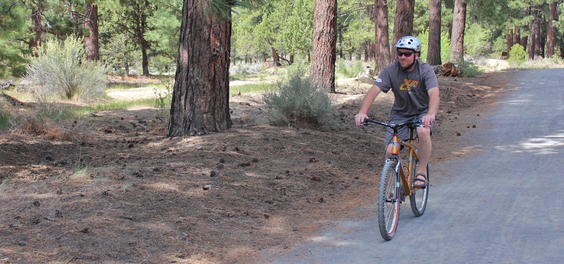 Image of a cyclist riding on the Larkspur Park Trail.