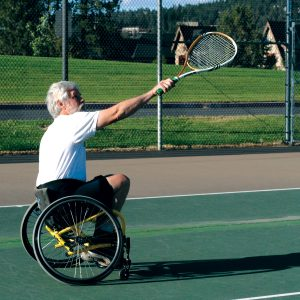 Image of an adaptive sport, wheelchair tennis, class participant.