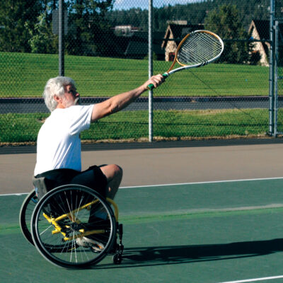 Image of an adaptive sport, wheelchair tennis, class participant.