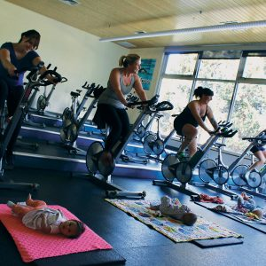 Image of a Baby and Me cycling class at Juniper Swim and Fitness Center.