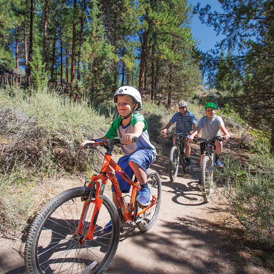 Image of a family cycling at Shevlin Park in Bend, Oregon.