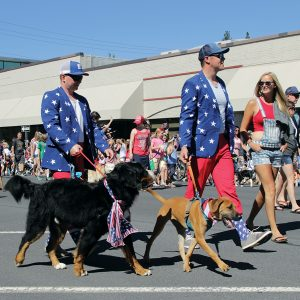 Image of people and dogs in the Fourth of July Pet Parade, hosted by Bend Park and Recreation District.