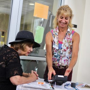 Photo of a fitness coordinator measuring BMI at a health workshop at the Bend Senior Center.