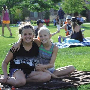 Image of two teens at a free community event, Let's Picnic, in Bend.