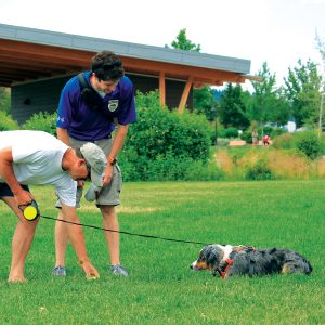 Image of a Park Steward performing on-leash dog outreach in Bend parks.