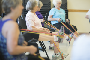 Image of older adults participating in a functional fitness class for seniors.