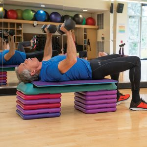Image of an athlete lifting weights in a strength and conditioning class at Juniper Swim and Fitness Center.