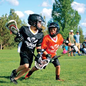 Image of youth lacrosse players in Bend, Oregon.