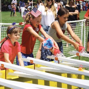 Image of kids at the July 4th Pet Parade and Old Fashion Festival in Downtown Bend, Oregon.