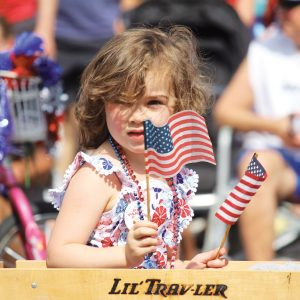 Image of a kid in the July 4th Pet Parade in Bend, Oregon.