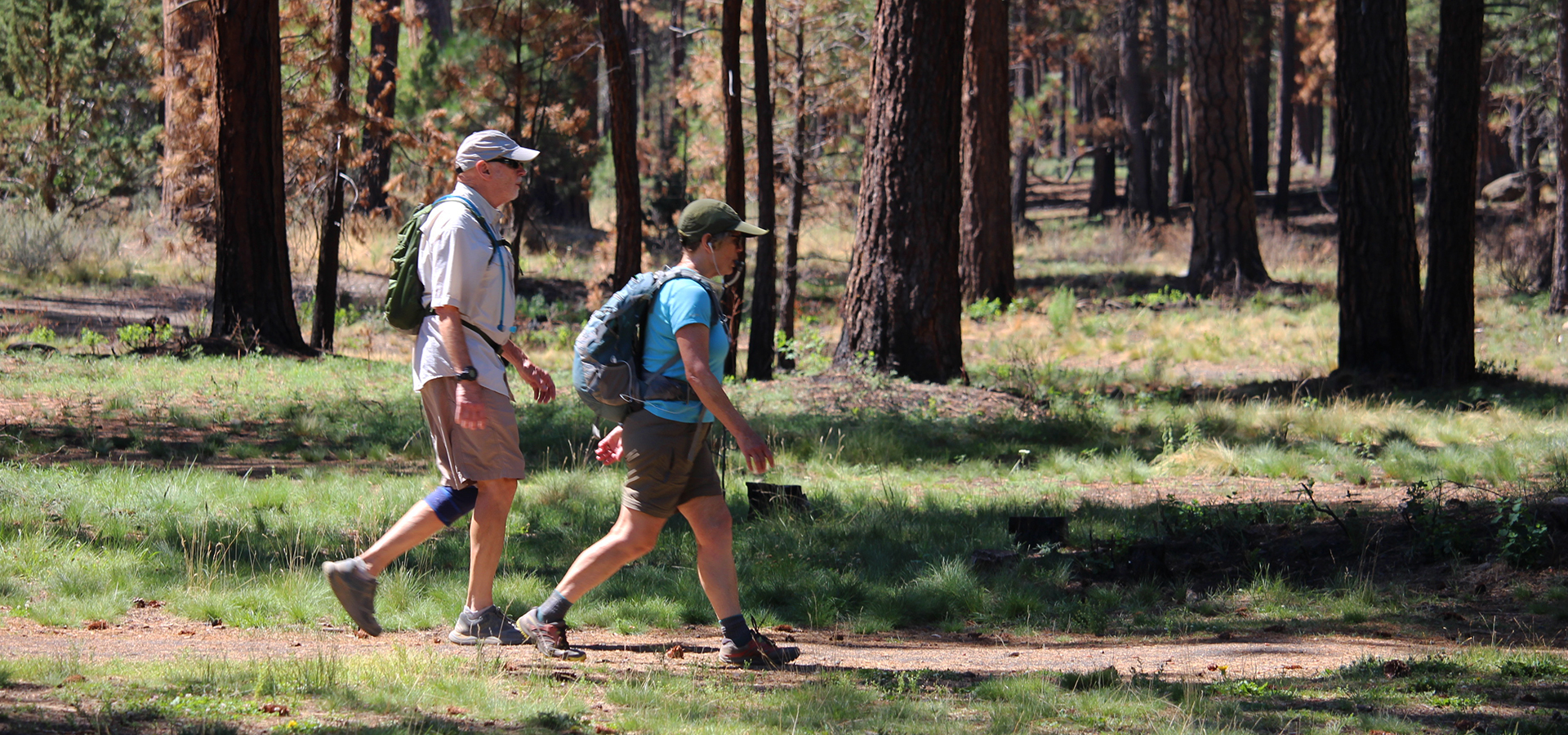 Image of couple walking on a soft-surface trail through Shevlin Park.