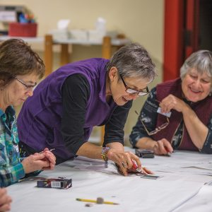 Image of an adult art class at the Art Station.