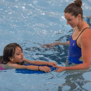 Image of a Youth Swim Coach at Juniper in Bend, Oregon.
