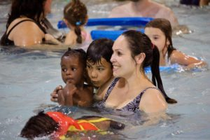 Image of kids and families swimming at Free Family swim night at Juniper Swim and Fitness Center in Bend.