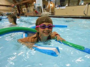 Image of kids swimming at Weekends Rock at Juniper Swim and Fitness Center in Bend.