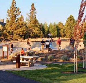 Image of skateboarders and scooter riders at Rockridge Skate Park in Bend, Oregon.