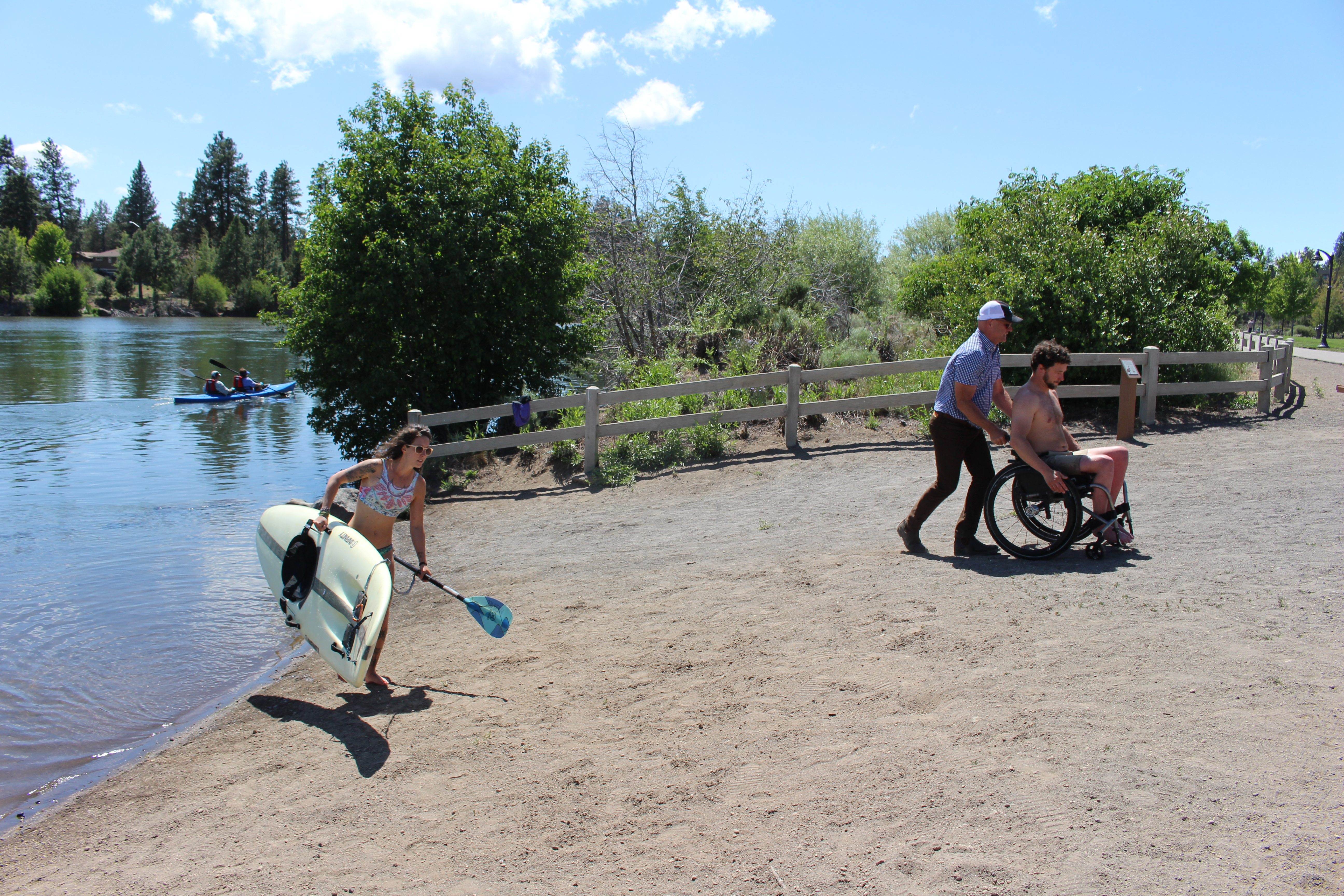 Image of park patrons at River Bend Park beach access.
