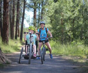 Child on adaptive bike in Shevlin Park