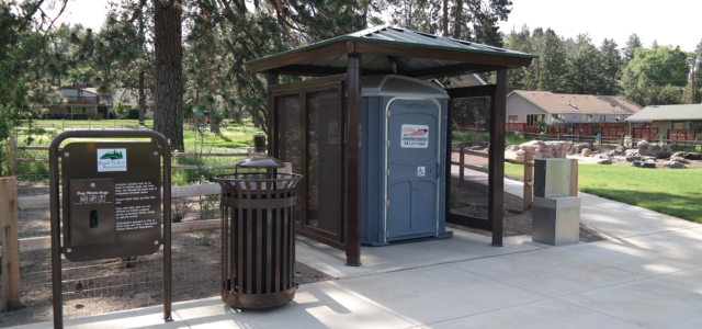 Image of Goodrich Park entrance and covered, seasonal restrooms.